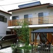 台形敷地に沿う家
